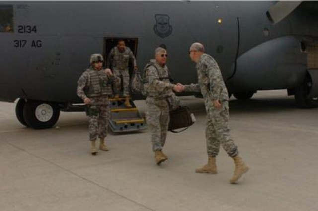 Gen. Benjamin Griffin, commander of United States Army Materiel Command from Fort Belvoir, Va., steps off the plane Oct. 22 to greet Brig. Gen. Michael J. Lally, commander of 3d Sustainment Command (Expeditionary), during his visit to Joint Base Balad.