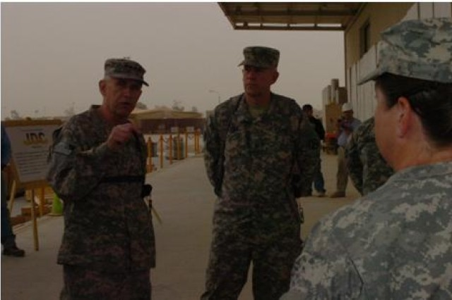 Gen. Benjamin Griffin (left), commander of Army Materiel Command, is briefed on the operational procedures at the Joint Distribution Center by 3d Sustainment Command (Expeditionary) commander, Brig. Gen. Michael J. Lally, during a visit to the 3d ESC and Joint Base Balad Oct. 22.