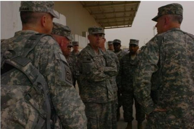 AMC commander, Gen. Benjamin Griffin, receives a briefing by Soldiers at the Joint Distribution Center Oct. 22.  AMC is headquartered in Fort Belvoir, Va. and is located in about 149 locations worldwide, including 43 states and 45 countries.