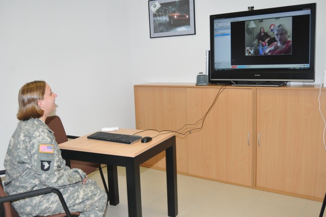 Sgt. Sheena Whitney, a mechanic with the Ohio National Guard, receives a pleasant surprise at the Landstuhl Regional Medical Center USO Warrior Center grand opening Oct. 21. USO staff coordinated an unexpected video teleconference with her mother and sister. The multi-purpose room is also equipped with donated equipment such as a Nintendo Wii gaming system and all the latest peripherals.