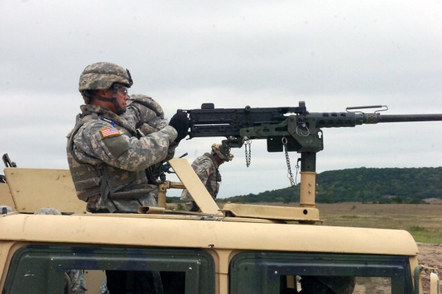 Kalispell, Montana native, Pfc. Duane Cooper, a canon crew member for Battery A, 3rd Battalion, 82nd Field Artillery Regiment, 2nd Brigade Combat Team, 1st Cavalry Division, mans the .50 caliber machine gun for his squad's humvee on Oct. 17 at the Sugarloaf Multi-Use Range at Fort Hood.