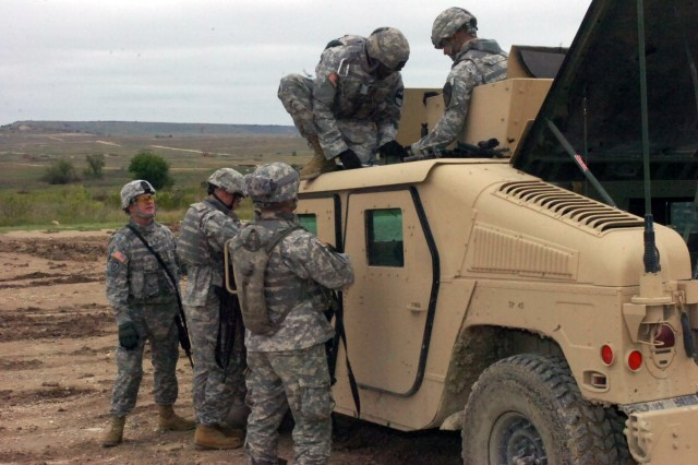 Soldiers from Battery A, 3rd Battalion, 82nd Field Artillery Regiment, 2nd Brigade Combat Team, 1st Cavalry Division perform minor repairs on a humvee before it goes back on the range on Oct. 17 at the Sugarloaf Multi Use Range at Fort Hood.