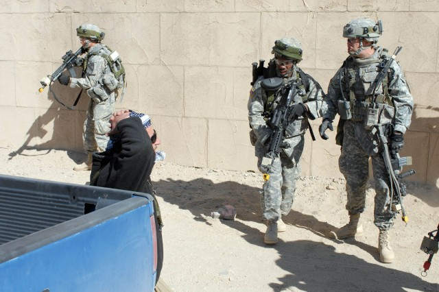 """White Platoon Soldiers from 2nd """"Lancers"""" Battalion 5th Cavalry Regiment, 1st Brigade Combat Team, 1st Cavalry Division, come face-to-face with the high valued """"target"""" they were to bring in for questioning during a training exercise at Ft. Irwin, Calif. Oct. 13."""
