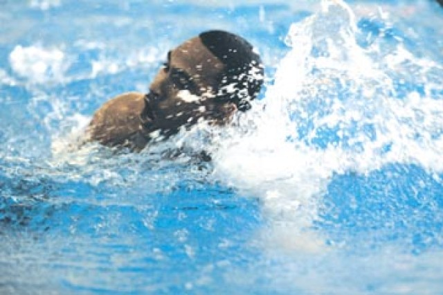 Sergeant First Class Ramone Manzano, senior small group leader at the NCO Academy, competes in the swimming event of the German Armed Forces Proficiency Badge competition at Newman Pool,  Oct. 8.