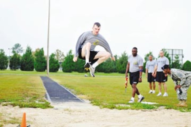 Sergeant First Class William Staun IV performs the long jump during the German Armed Forces Proficiency Badge competition at Fort Stewart's Quick Track, Oct. 9.