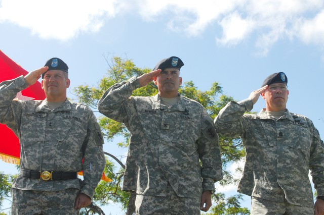 MG Raymond V. Mason, left, Commanding General, 8th Theater Sustainment Command, Col. Fabian Mendoza, center, 130th Engineer Brigade commander, and Command Sgt. Maj. Michael Buxbaum, Corps of Engineers Command Sgt. Maj., salute the flag during a ceremony at Schofield Barracks' Sills Field Oct. 23.  The ceremony uncased the colors of the 130th Eng. Bde. and officially completed the units' move from Germany to Hawaii.