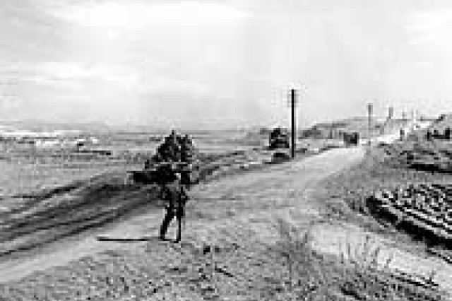 Photo #: NH 97058  Armored vehicles moving inland from the beaches, during the landing of the Seventh Infantry Division at Iwon, North Korea, circa late October 1950.  Official U.S. Navy Photograph, from the collections of the Naval Historical Center.