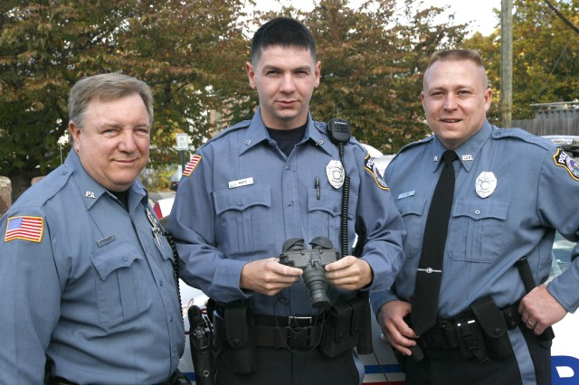 Picatinny Arsenal police officers (from left to right) Thomas Vecchi, Jonathan White, and Cary Dul used night-vision-goggles to assist in the search of a missing hiker in a local community surrounding the installation.