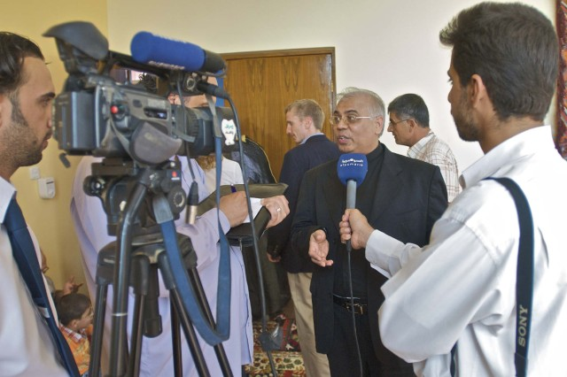 Catholic Archbishop Francis Assisi Chullikat, the apostolic nuncio for Iraq's Catholics, speaks to a Nasiriyah television crew during his historic visit to the Ziggurat and the Long Knife Brigade in Tallil, Iraq, Oct. 23.