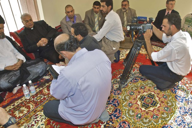 Catholic Archbishop Francis Assisi Chullikat, the apostolic nuncio for Iraq's Catholics, speaks to business and religious leaders and reporters from the Nasiriyah area during his visit to the Ziggurat and the Long Knife Brigade in Tallil, Iraq, Oct.