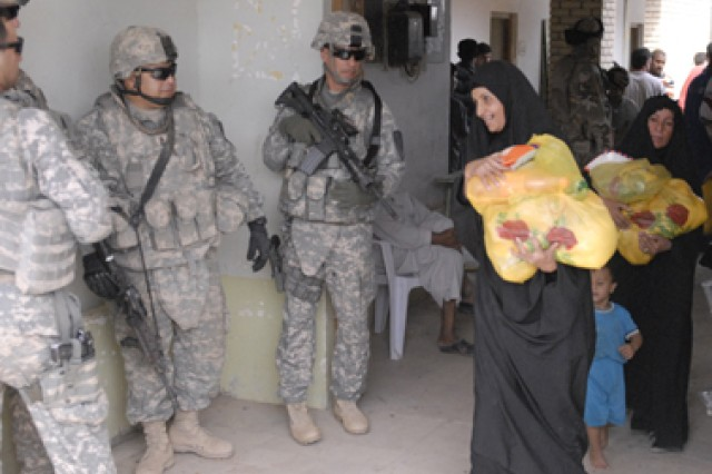 An Iraqi woman from Majarr al-Kabir, Iraq, thanks Soldiers of 2-7th Cav. Regt. for assisting during the non-government food drop Oct. 25. The al-Yaq Dha al-Thaka Pia Foundation and the Maysan PRT helped provide food to some of the local Iraqi citizens