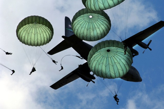 The Army 82nd Airborne Division, from Fort Bragg, N.C., performs a mass jump with 120 members during the 56th annual Department of Defense 2006 Joint Service Open House (JSOH) hosted at Andrews Air Force Base, Md., May 20, 2006. The 82nd Airborne Division's real world mission is to within 18 hours of notification, strategically deploy, conduct forcible entry parachute assault and secure key objectives for follow-on military operations in support of U.S. national interests. (Released)