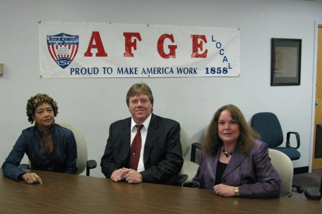 From left are AFGE Local 1858 administrative assistant Mae Nell Perkins, president Don Eiermann and labor relations officer Vicki Fuller.