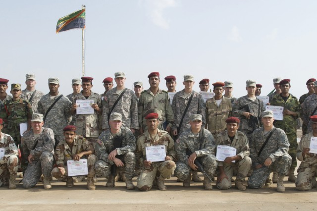 The 10th IA Division's first route clearance team poses with their American cadre after the first Route Clearance Academy graduation ceremony at Camp Dhi Qar, Iraq, Oct. 26.