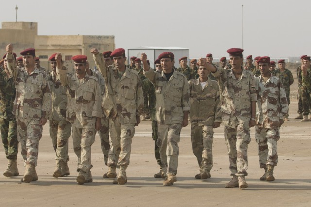 The 10th IA Division's first class of route clearance engineers marches during their graduation ceremony at Camp Dhi Qar Oct. 26. The troops are the first of 50 Iraqi soldiers scheduled to become roadside Sappers.