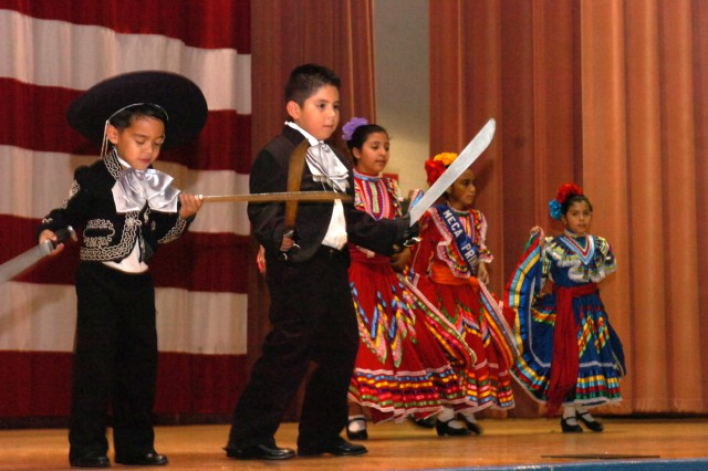 Dancers from the Multi Ethnic Cultural & Arts Association perform traditional dances. Performers of all ages show dances from different Hispanic nations at the Hispanic American Heritage Observance event at Howze Theater on Fort Hood, Texas, Oct. 9.