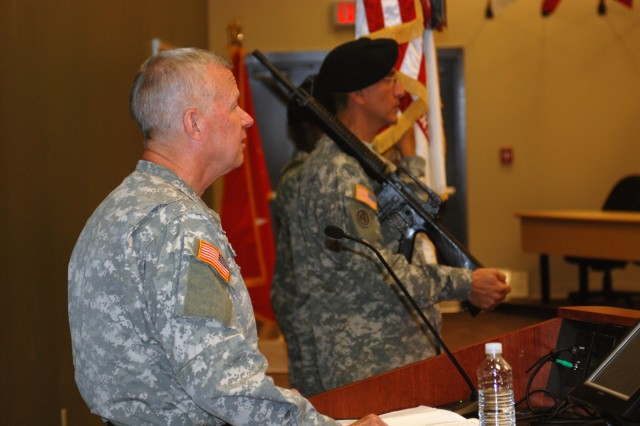 """Maj. Gen. Charles E. Gorton, commander of the 81st Regional Support Command, talks with Soldiers and civilians assigned to the command and local community leaders about the """"Wildcats"""" during the uncasing ceremony held Sept. 26 at Fort Jackson."""