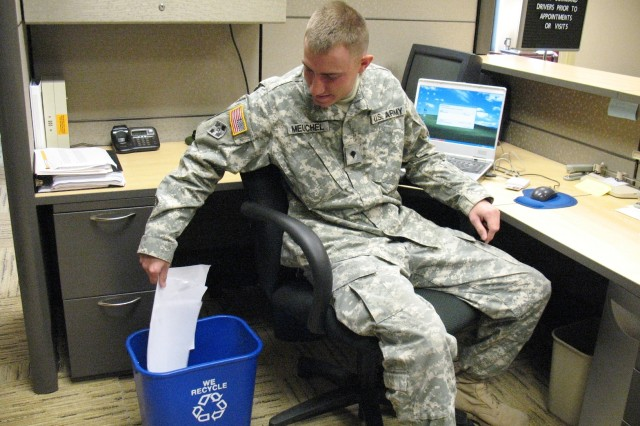 Spc. Joshua Meuchel recycles paper at the 41st Fires Brigade headquarters on Fort Hood, Texas.