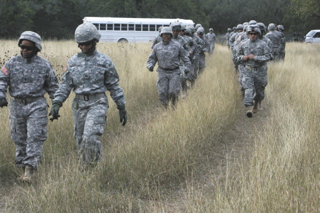 Soldiers from the 582nd Medical Logistics Company, Fort Hood, Texas, head toward a landing zone during helicopter sling load training Oct. 23 at a field training exercise at Camp Bullis. More than 200 Soldiers from the 61st Multifunctional Medical Battalion participated in the medical logistics operation.