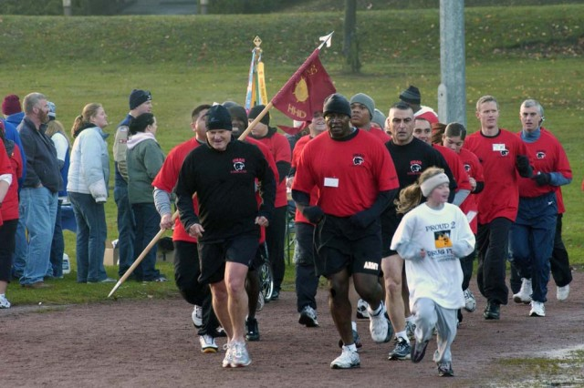 Maj. Gen. Yves Fontaine, left, commanding general of the 21st Theater Sustainment Command and Army senior mission commander for the Kaiserslautern military community in Germany, and the 21st TSC Command Sgt. Maj. David Wood, right, run with the 39th Transportation Battalion in the U.S. Army Garrison Kaiserslautern's Red Ribbon Relay held Oct. 25. The 39th Transportation Battalion won the unit award for most average laps per runner - a new award this year. Each runner logged an average of 14.8 laps