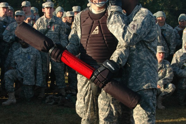 Drill Sgt. (Staff Sgt.) Steve Devot, D Battery, 1st Battalion, 19th Field Artillery gives Pvt. Corey Komodle, A Battery, 1st Battalion, 40th Field Artillery, some last minute tips before he faces his opponent in the pugil tournament during the 434th Field Artillery Brigade Combat Olympics Oct. 25.