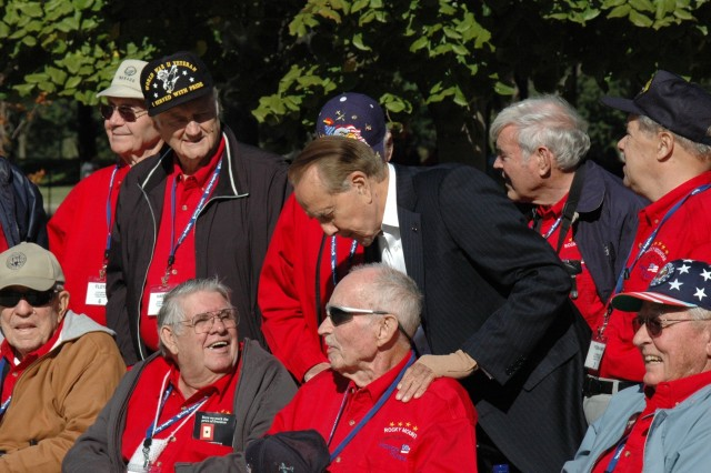 Senator Bob Dole meets with WWII veterans in front of the WWII memorial in Washington D.C. during the veterans' recent trip with the Rocky Mountain Honor Flight. Senator Dole chatted with the veterans for close to an hour, listening to their stories and sharing his own from the war.
