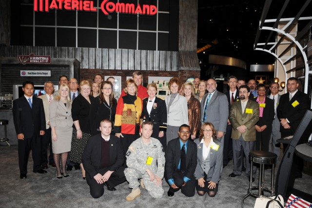 Lt. Gen. (P) Ann. E. Dunwoody, deputy commanding general Army Materiel Command, poses with all the AMC exhibitor participants.  ""