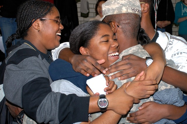 Sgt.1st Class Danny J. Hocker, assigned to 2nd Squadron, 2nd Stryker Cavalry Regiment, is embraced by his family during a welcome home ceremony in Vilseck, Germany, Oct. 23, 2008. Hocker is returning to Germany after a 15-month deployment in support of Operation Iraqi Freedom.