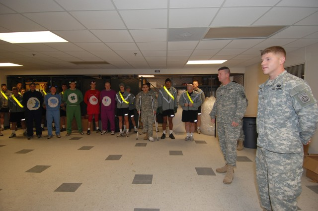 Sgt. Levi Trull, an Ashland, Ohio, native, had a few special guests at his promotion to sergeant on Halloween, the Carebears. Several members of the intelligence section of Headquarters, 2 BCT, 82nd Airborne Division, dressed up for the company Halloween run. Before the run Trull was promoted, he also turns 21 on Nov. 1. (U.S. Army photo by Sgt. Susan Wilt, 2 BCT, 82nd Abn. Div. PAO)