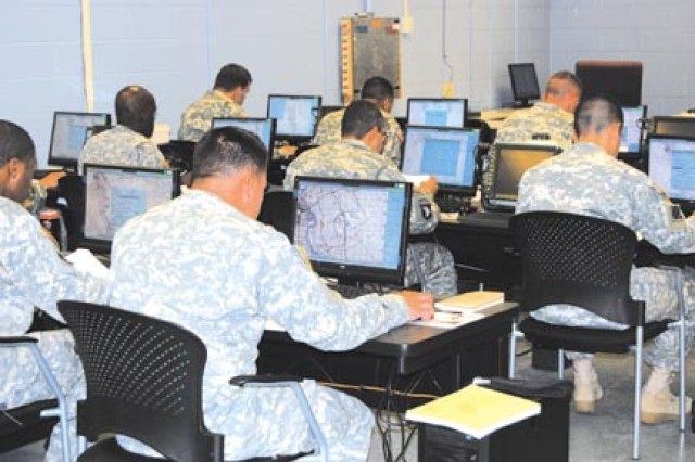 Soldiers stationed at Fort Stewart take a test on the Blue Force Tracker system Oct. 23 in the first MTT BNCOC held here. More than 30 Soldiers are participating in the 25B and 25U courses that allows them to attend school at home station.