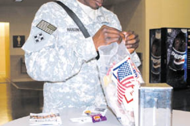 Spc. Djuan Harrington, Co. E, 1/10 CAB, sorts through items he received from the USO as he waits to depart Hunter, Oct. 21.