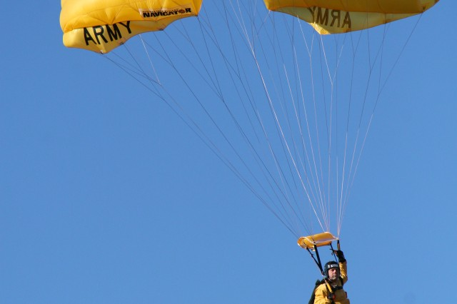 Sgt. 1st Class Daniel Metzdorf makes the final approach during the 2008 Graduation demonstration for the U.S. Army Parachute Team. Metzdorf, an above the knee amputee was part of the 12 selectees to complete the Golden Knight Assessment and Selection.