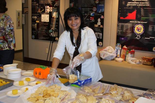 Mrs. Nguyet Borja, wife to SMDC/ARSTRAT CSM Ralph Borja, sets up crackers and cornbread for those eating chili and soup.