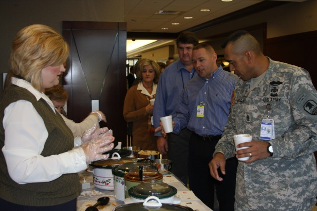 Barbara Dixon offer CSM Borja and other waiting guests their choice of more than six different types of chili and soup.