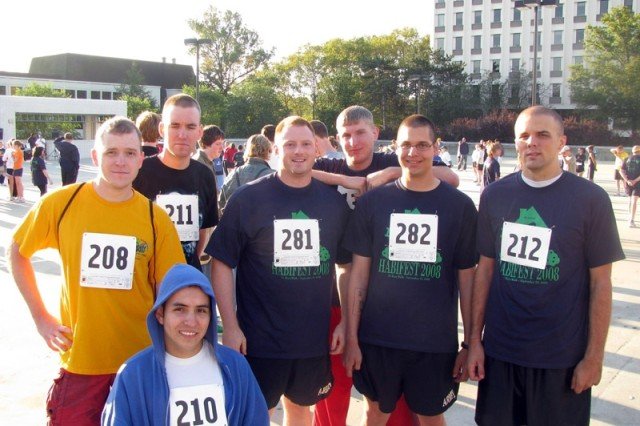 Spc. Jedidiah Berry, Sgt. Matt Davidson, Sgt. Nick Murja, Spc. Scott Oleath, Spc. Adam Olson, Sgt. John Wischmeier and Spc. Roy Dilworth (kneeling), of Bravo Company, 53rd Signal Battalion, participated in Habifest, a Habitat for Humanity 5K run that took place Sept. 20 in Howard County, Md.