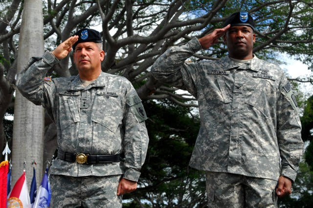 MG Raymond V. Mason, Commanding General, 8th Theater Sustainment Command, and Col. Byron Freeman, 8th Military Police Brigade commander, salute the national colors during a deployment ceremony on Schofield Barracks, Hawaii, Oct. 31.