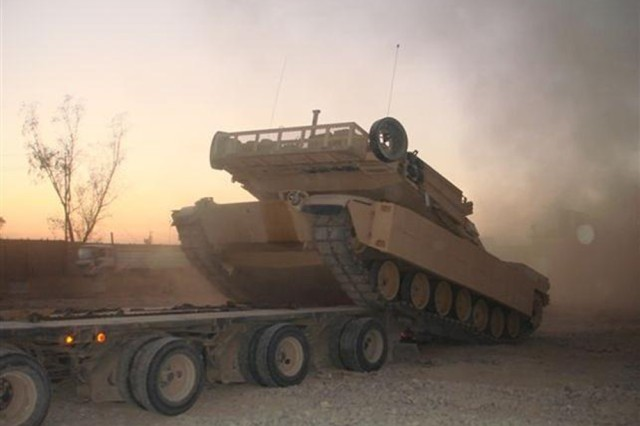 The Army's Heavy Equipment Transport system, or HET, is capable of transporting a wide range of tactical vehicles, including the Abrams M1 Main Battle Tank, weighing nearly 70 tons.