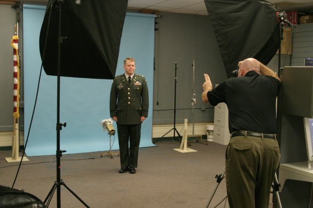 FORT SHAFTER, Hawaii - Manager of the Department of the Army Photo Lab, Marc Parrone, right, directs Lt. Col. Michael Hammerstrom, Special Operations Component, U.S. Pacific Command, during a photo session. Parrone, along with his employees at two operating photo labs on the installations, offers an array of photographic services for Soldiers, including command headshots and official DA photos.