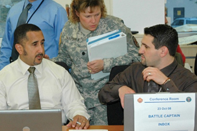 Members of the U.S. Army Garrison Wiesbaden's Emergency Operations Center monitor the unfolding situation during a two-day Installation Force Protection Exercise in Germany.
