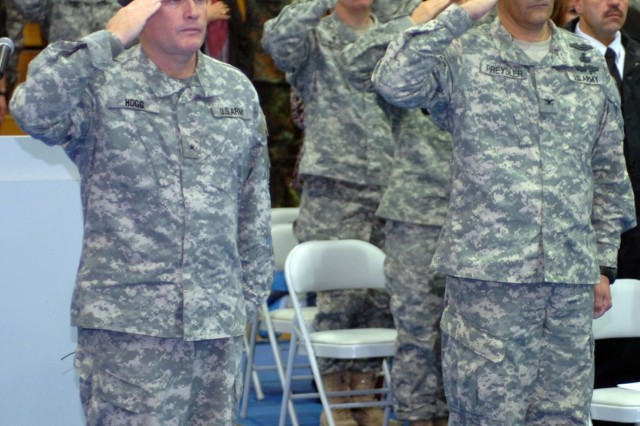 Hohenfels, Germany -- Brig. Gen. David R. Hogg (left) and Col. Charles A. Preysler salute during the playing of the National Anthem. Preysler took command of the Joint Multinational Readiness Center during an Oct. 21 ceremony.
