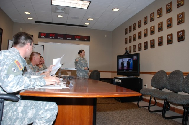 The 1st Space Battalion has taken the 21st Century approach of conducting a traditional promotion board via video teleconferencing (VTC.) A VTC promotion board, conducted for the first time in the newly outfitted 1st Space Battalion Conference Room at the U.S. Army Space and Missile Defense Command/Army Forces Strategic Command Operations building on Peterson Air Force Base, Colo., took place during the afternoon of Oct. 24.
