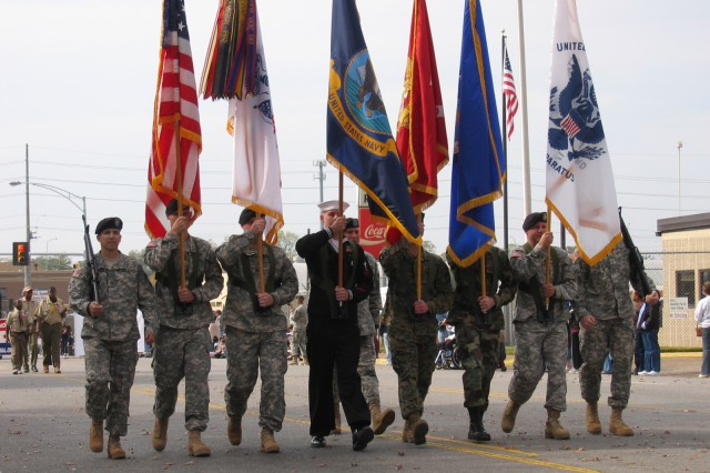 The Redstone Arsenal honor guard sets the pace for the 2007 Veterans Day Parade. Redstone Arsenal and its Soldiers will once again be front and center at this year's Veterans Day Parade, set for 11 a.m. Nov. 11 in downtown Huntsville. Hundreds of parade participants and spectators are expected along the two-mile parade route.