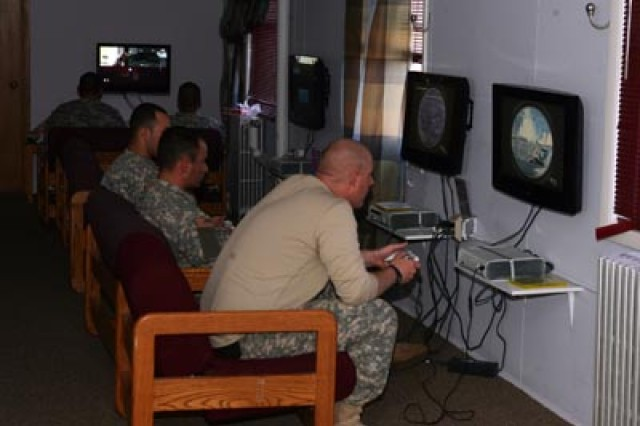 Soldiers play X-BOX 360 game systems at the Fort McCoy Community Activity Center.