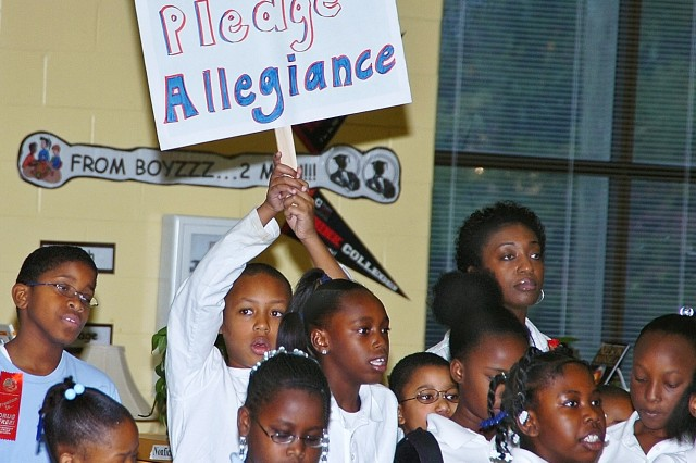 "The Perkerson chorus performs their rendition of the ""Pledge of Allegiance,"" for Col. Deborah B. Grays, commander of Fort McPherson and Fort Gillem Ga., who was their principal for a day on Oct. 28, 2008. The chorus is comprised of third-, fourth- and fifth-grade students."