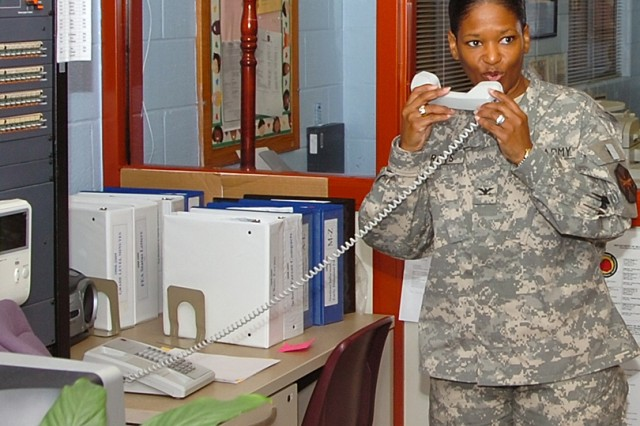 Col. Deborah B. Grays, commander of Fort McPherson and Fort Gillem, Ga. greets the student body over the intercom just before making the morning announcements at Perkerson Elementary School on Oct. 28, 2008 where she was principal for a day.