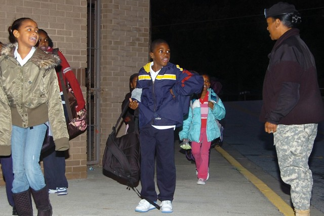 Col. Deborah B. Grays, commander, U.S. Army Garrison, Fort McPherson and Fort Gillem, Ga., greets students as they arrive at Perkerson Elementary School Oct. 28, 2008 to see their principal for the day.