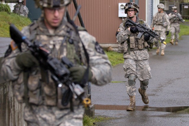 Soldiers from 3rd Platoon, C Co., 1-23 Inf. conduct operations at a water-treatment facility.