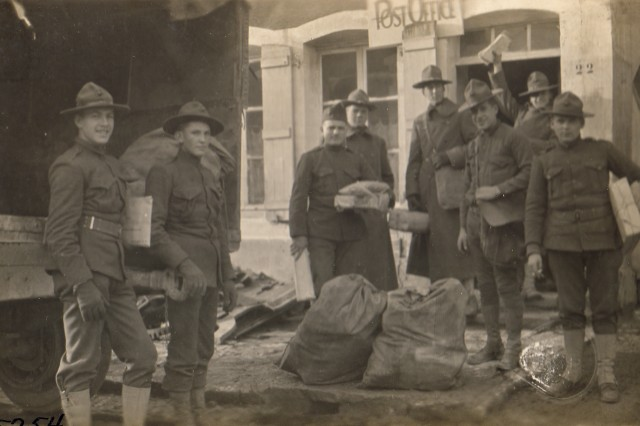 Christmas mail arrives for U.S. Soldiers during World War I, at Bruvans, France, 1917.
