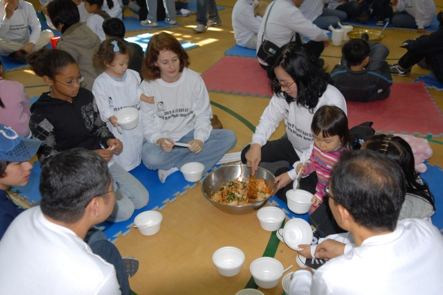 Korean and American Families share bibimbop, a mixture of rice and vegetables during Family-to-Family Friendship Day at Buyong elementary School, Gaeksari, South Korea on Nov. 1.