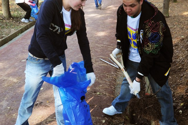 Staff Sgt. Christy Pritchard (left) and Pvt. Sando Hendrix of Alpha Company 527th Military Intelligence Battalion were among the 150 volunteers from Humphreys who participated in the first-ever Make A Difference Day in Korea at Deog Dong San Park in Pyeongtaek. To view or download a high-resolution version of this and other photos from Make a Difference Day visit http://www.flickr.com/photos/usaghumphreys/.